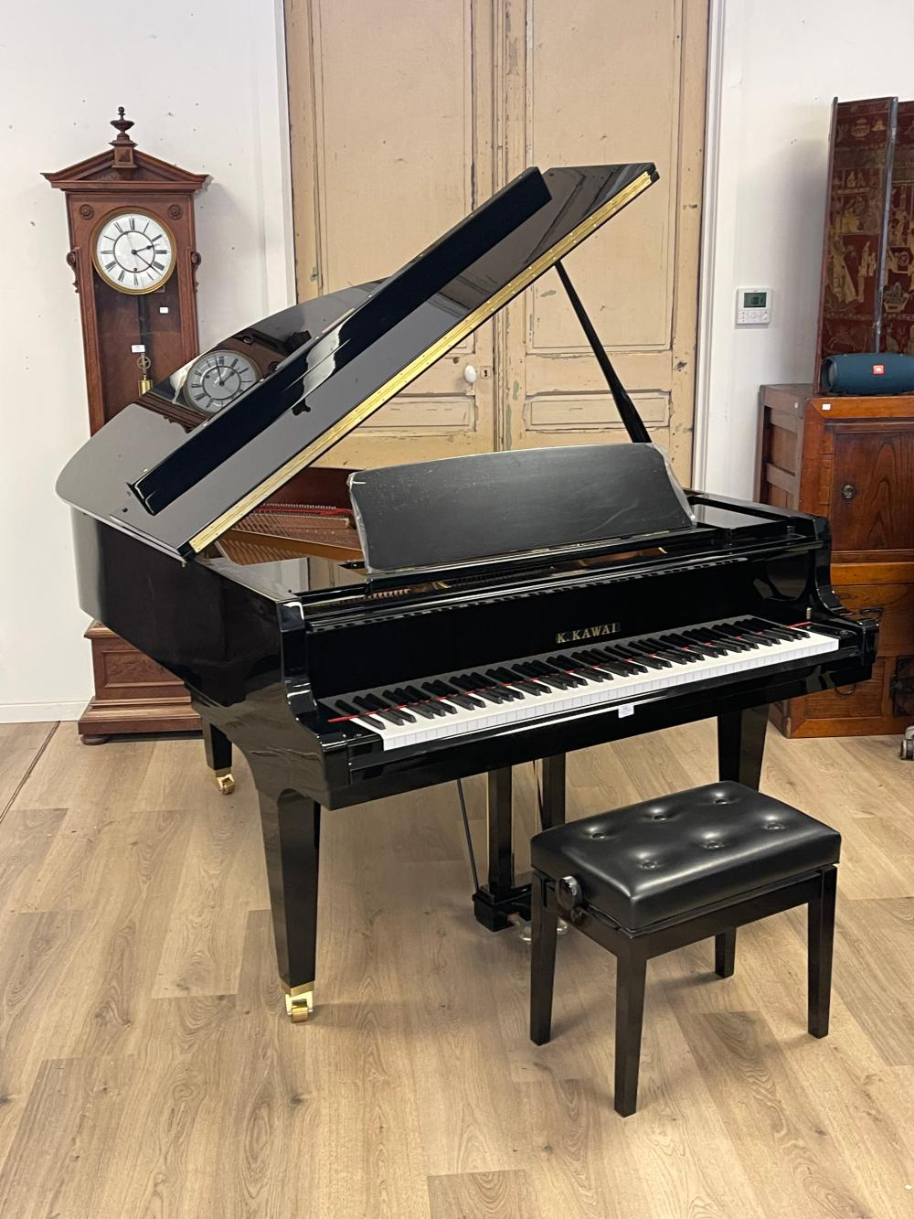 Pristine Kawai Grand Piano. Ebonized cabinet work along with a matching adjustable stool, dated 04/2017 model GL-40 Serial number 2703620. still retains plastic coating on sheet music stand and pedals…