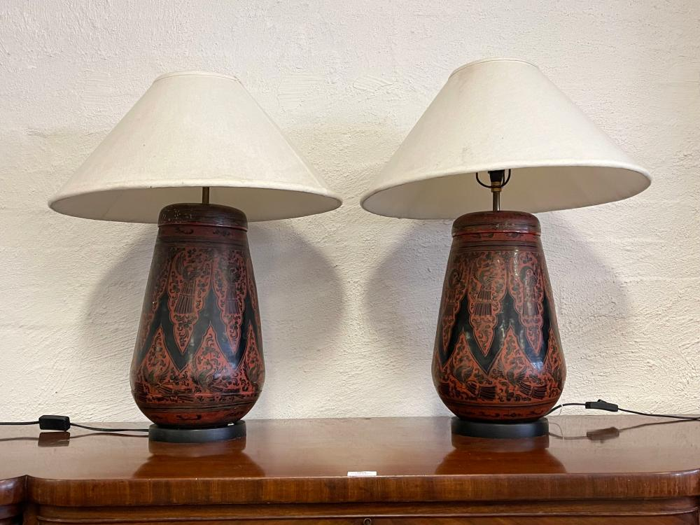 Pair of South East Asian red and black lacquer lidded containers converted to lamp, approx 66cm x 30cm with shades (2)