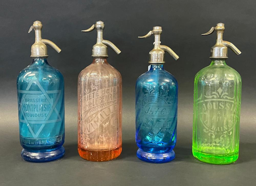 Four vintage French coloured glass soda siphons Various towns, Liz, Wimille, Toulouse, Le Raincy, each approx 31 cm (4)
