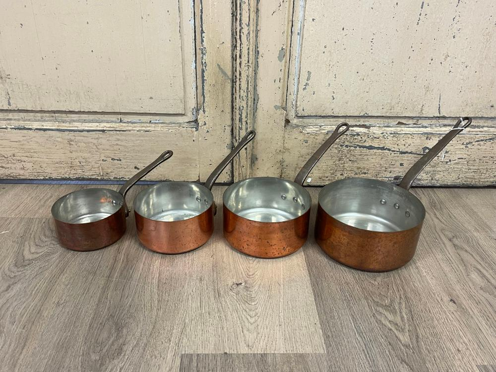 Set of four French copper and iron handled saucepans, stamped Fabrication France (4) 18cm dia largest pan