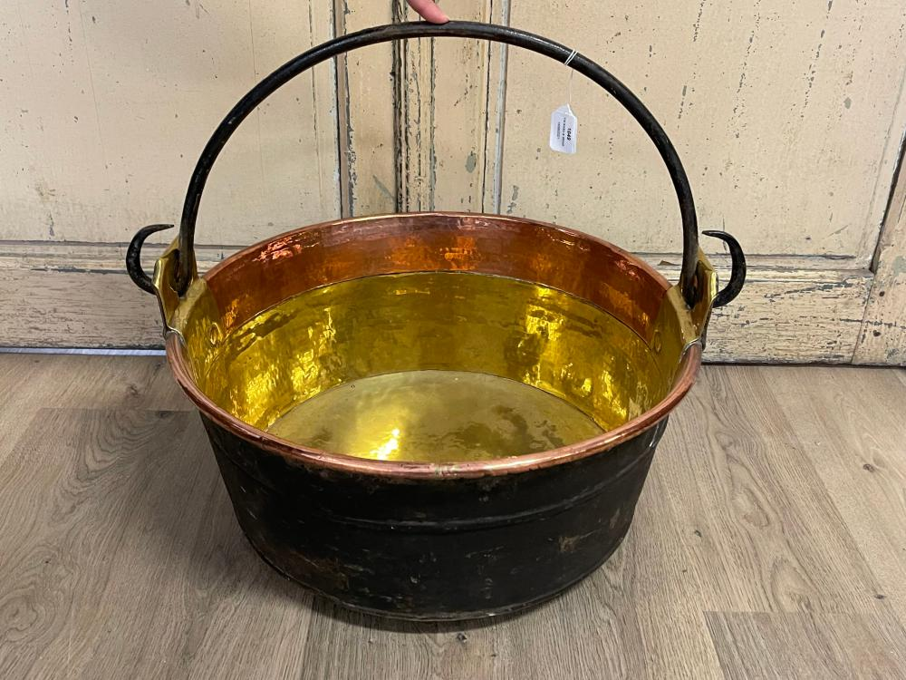 Antique 19th century French copper and brass pot of large size, with a wrought iron swing handle, 53 cm dia approx