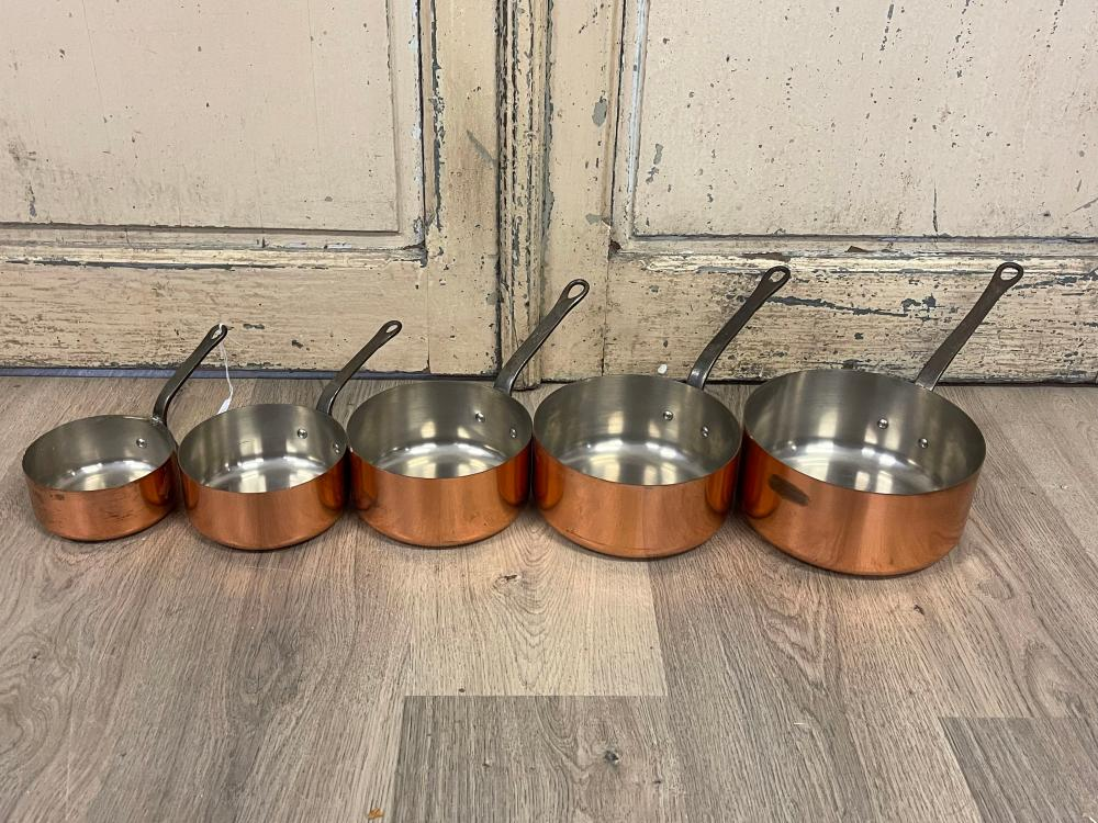 Set of five French copper sauce pans, stamped Tournus to handles, Largest pan 30 cm dia (5)