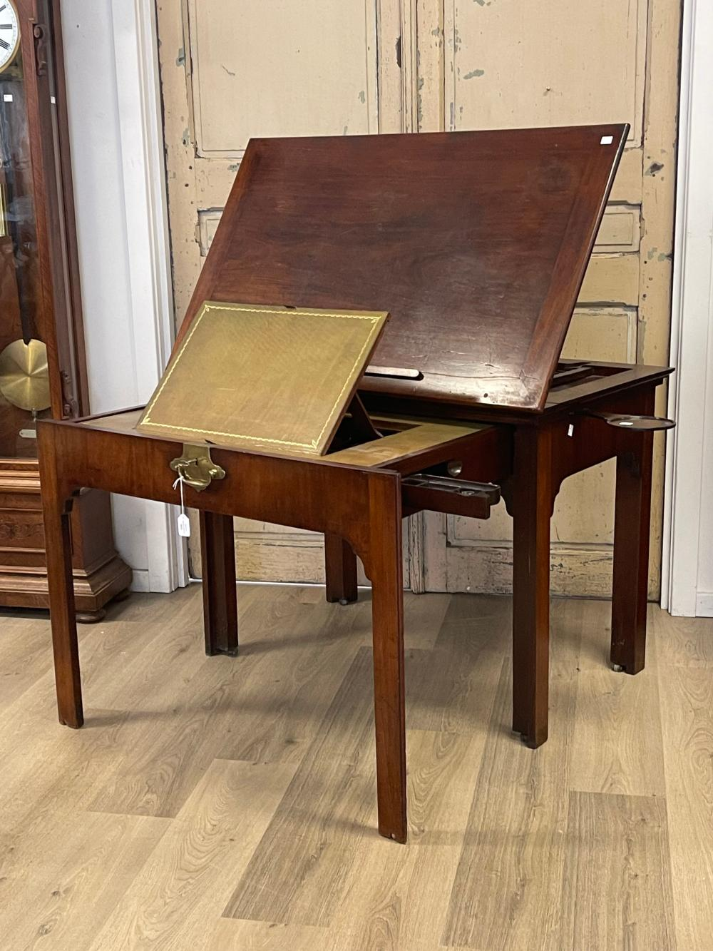 Antique George III mahogany Architects desk, lift up adjustable drawing surface, pull out front with fitted interior, with leather writing surface, and sectional interior, original brass lock with key. Pull out candle…