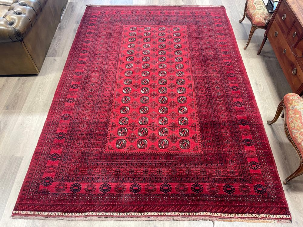 Hand knotted pure wool Afghan Bukhara carpet, approx 299cm x 204cm