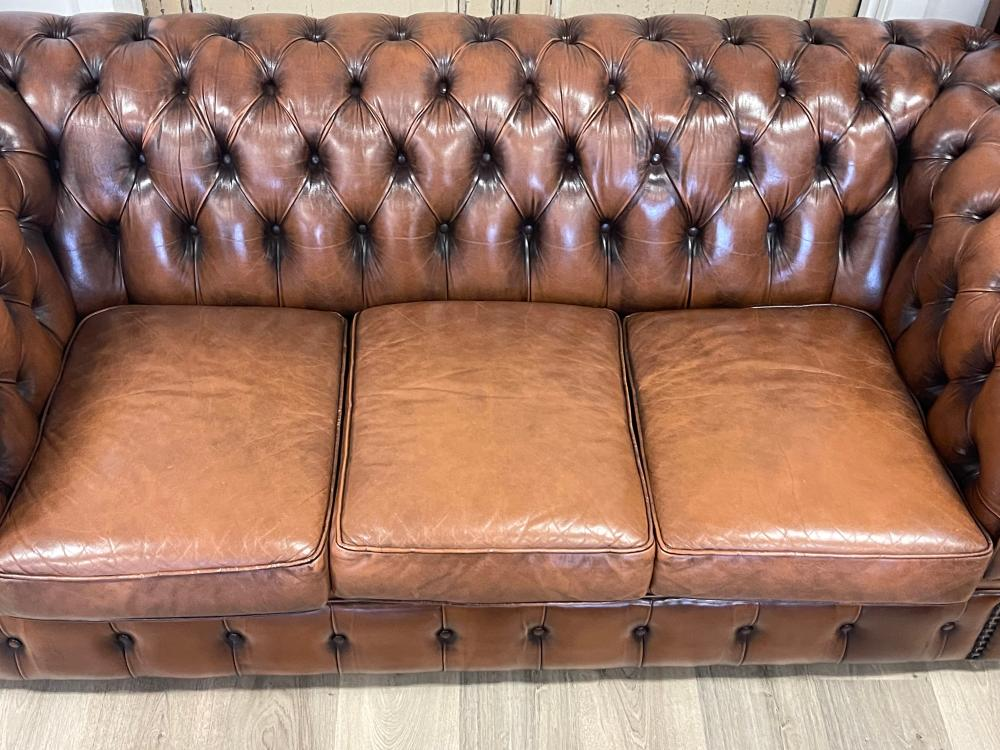 Moran brown leather deep buttoned three seater Chesterfield, approx 67cm H x 193cm W x 91cm D