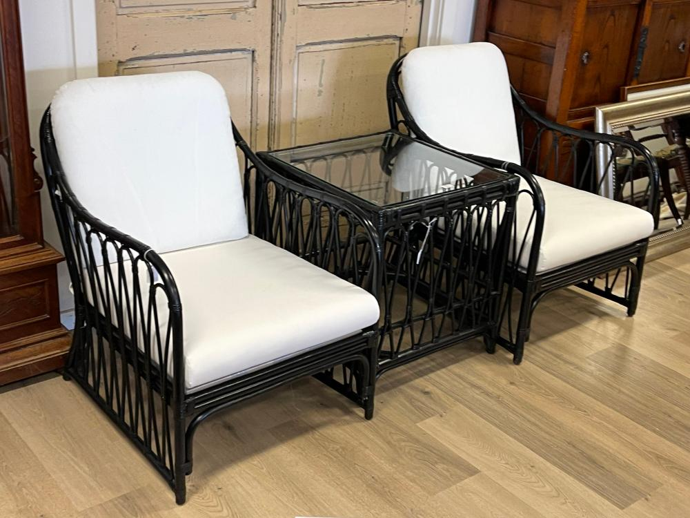Modern three piece black lacquer cane suite, comprising a pair of arm chairs and glass topped square table, table approx 64cm H x 61cm sq (3)