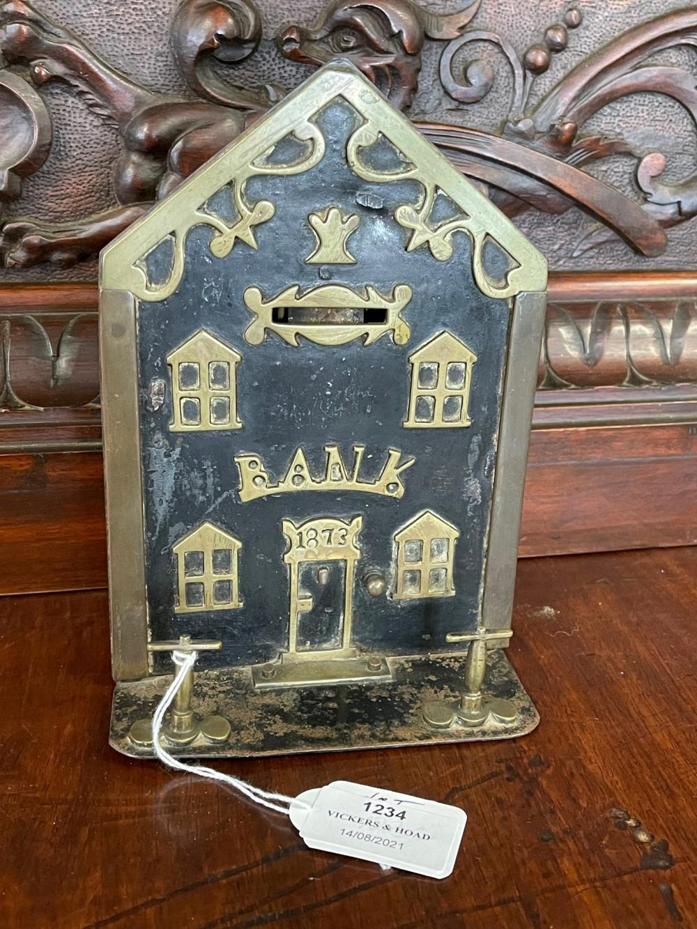 Antique English brass and metal money box in the form of a bank, dated 1873, approx 18cm H x 13cm W