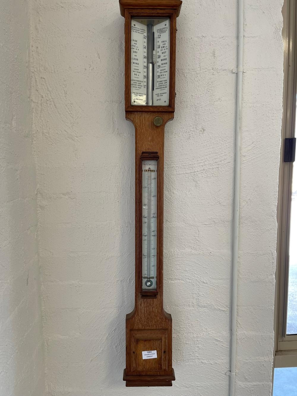 Fine antique English oak cased stick barometer, by Negretti and Zambre makers to her Majesty. Hatton Garden Long address, intact with mercury, approx 102cm H