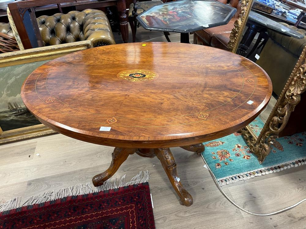 WITHDRAWN - Antique English oval inlaid walnut loo table, carved central column with four out swept legs, 119 cm long x 70 cm high