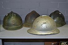 Four Antique French fireman's helmets (4)