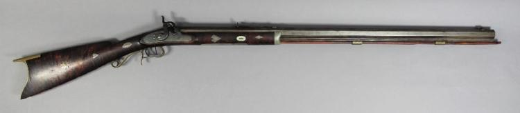 Superb F. Ebner American percussion plains rifle circa 1855-60. Half stocked in finely figured tiger maple with crescent brass butt plate and trigger guard, inlaid with silver stag, heart, star, etc. Approx 124cm overall with 84cm very heavy octagonal barrel in .36 calibre. Made by F. Ebner and so marked. Side action lock. Completely original and untouched.
