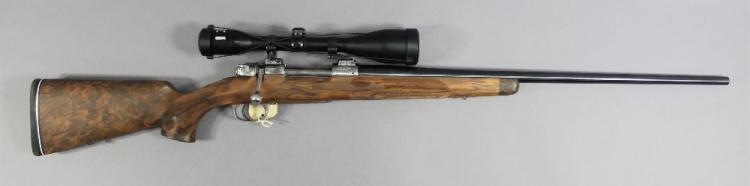 Bolt action repeating rifle in 6.5 x 55 calibre, built on Argentine M1909 action made by DWM. Engraved action etc high grade checkered walnut stock. Fitted with Artemis 2000 7 x 50 telescopic sight. Serial no. E2636A