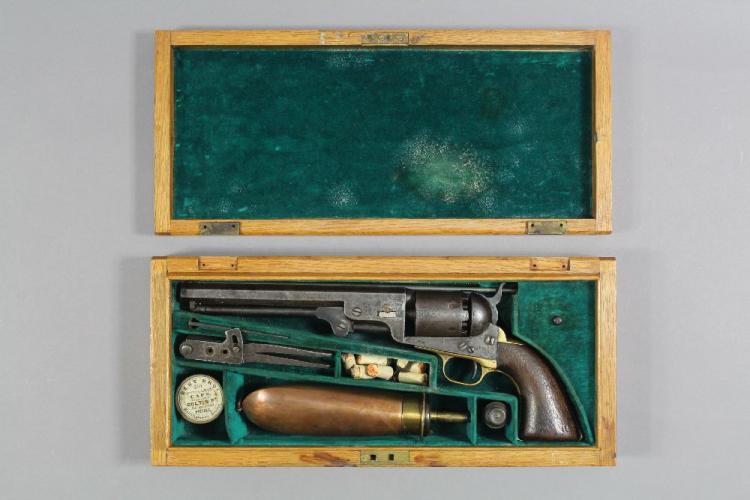 Colt M1851, Navy revolver in modern case with original powder flask, bullet mold, tool, etc
