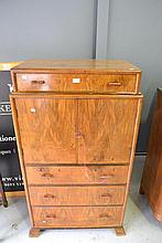 Art Deco Walnut tall two door cabinet with drawer