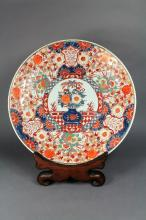 Antique Imari pattern charger with rosewood stand, approx 46cm Dia