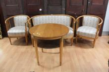 Jugend Salon suite comprising a sofa, chairs and a matching side table. In Moulded beech and gold decorated highlights early 20th Century, table approx 70cm H x 74cm dia (4)