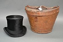 Antique English top hat in a leather hat box with