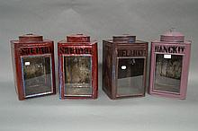 Four old tin shop canisters with glass fronts (4)