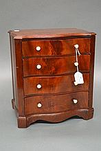 Antique mahogany miniature serpentine front chest