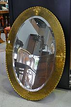 Good vintage hand beaten brass surround oval