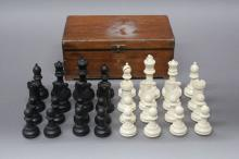 Vintage box with chess set pieces, approx 9cm H x 24cm L x 15cm D