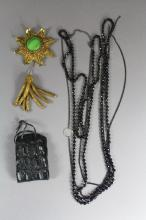 Jewellery lot to include a gold brocade rank badge, a croc cuff bracelet as well as black faceted bead necklace.