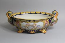 Antique French faience jardiniere with putti decoration, twin dragon handles, signed A Montagnon, approx 18cm H x 43cm W x 25cm D