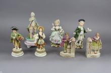Assortment of estate porcelain to include two pairs of female and male figures, a pair of bookends, a male figure, approx 20cm H and smaller (7)