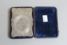 An early Victorian card case in sterling silver, heavily engraved with scroll work and engine turning, in original box marked Birmingham, 1842, JW, approx 10cm x 7cm, 77g