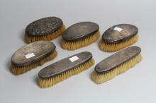Antique to mid-century dressing brushes with sterling silver mounts to include pair of pieces, mixed marks including a Chester example (6)