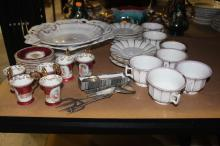 Assortment of porcelain and plate items to include cups and saucers, Demitasse cups and saucers, platters, teaspoons, etc