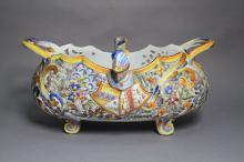Antique French St Clement pierced faience ware footed jardiniere with armour and shield decoration, approx 22cm H x 46cm L