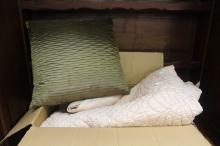 Assorted cushions along with a vintage quilt
