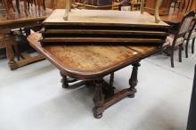 Extension dining table with three leaves and a container of casters (in office SC: a4418.6), approx 128cm x 115cm closed