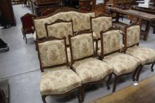 Antique French Louis XV style carved and gilt walnut seven-piece suite, comprising a settee, pair of arm chairs and four side chairs (7)