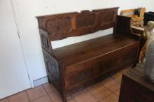 Antique French large size bench with lift up seat, the shaped and carved panelled back and sides, with carving low relief, approx. 128cm H x 170cm W x 74cm D