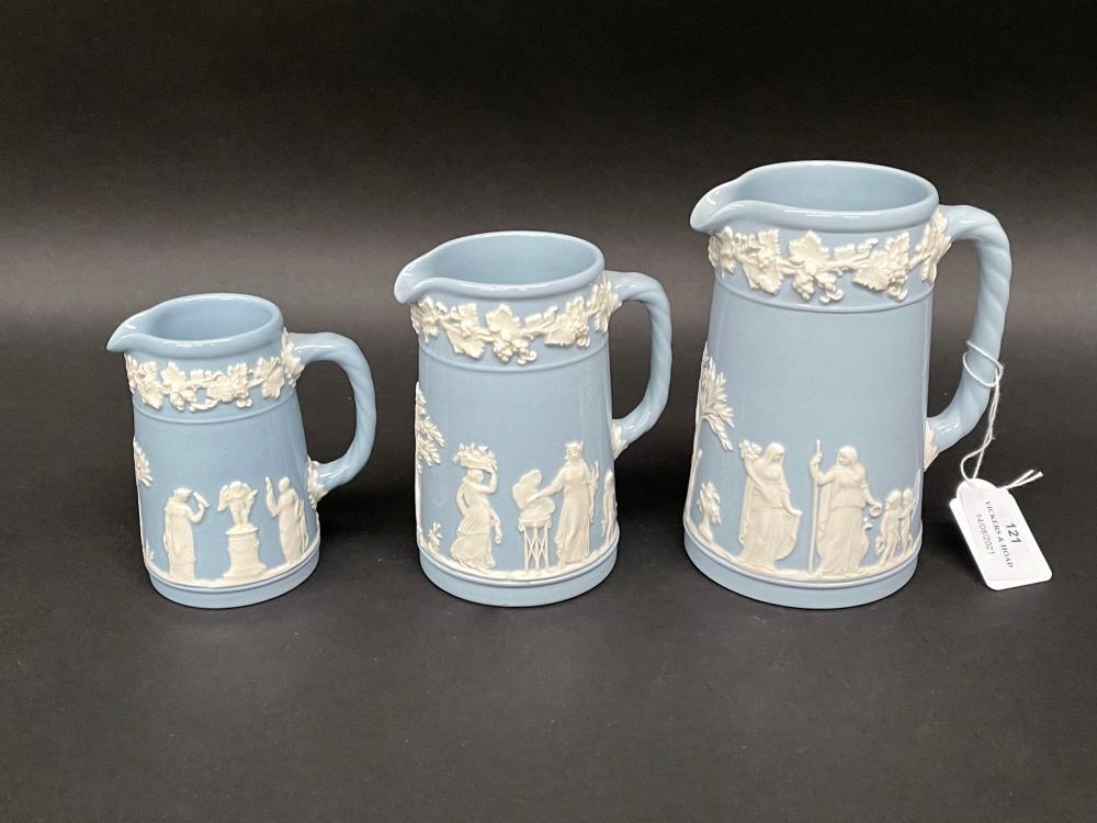 Three Wedgwood Blue jasper graduated jugs, approx 14.5cm H to 10cm H (3)