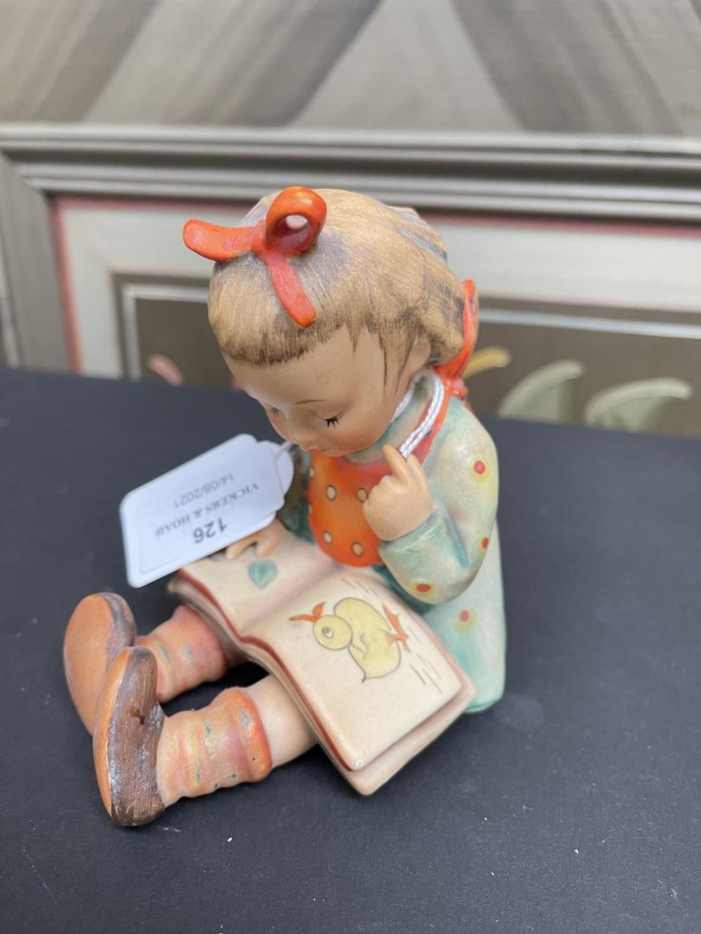 Hummell figure of a girl reading seated, approx 12cm H