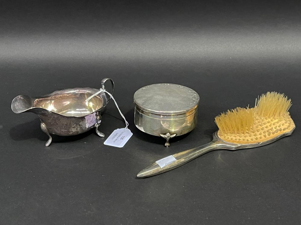 Antique and later sterling silver items, trinket box, sauce boat, hair brush, approx 25cm L and smaller (3)
