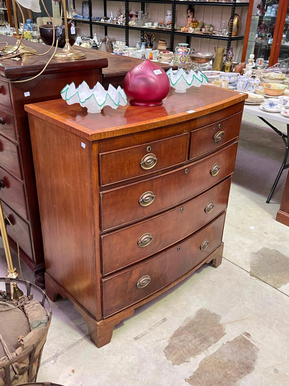 Antique late regency mahogany five drawer chest of bow front shape with brass handles, approx 106cm H x 96cm W x 52cm D