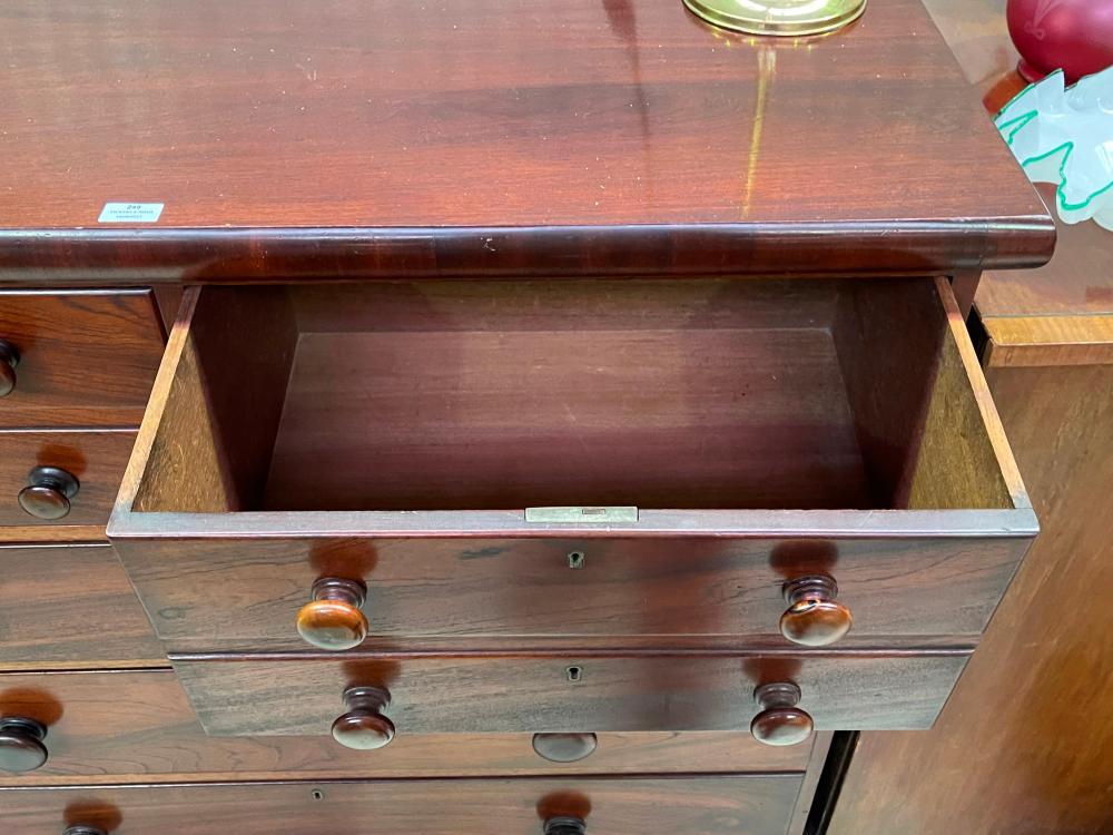 Antique Australian cedar five drawer chest with key on turned feet, approx 125cm W x 120cm H