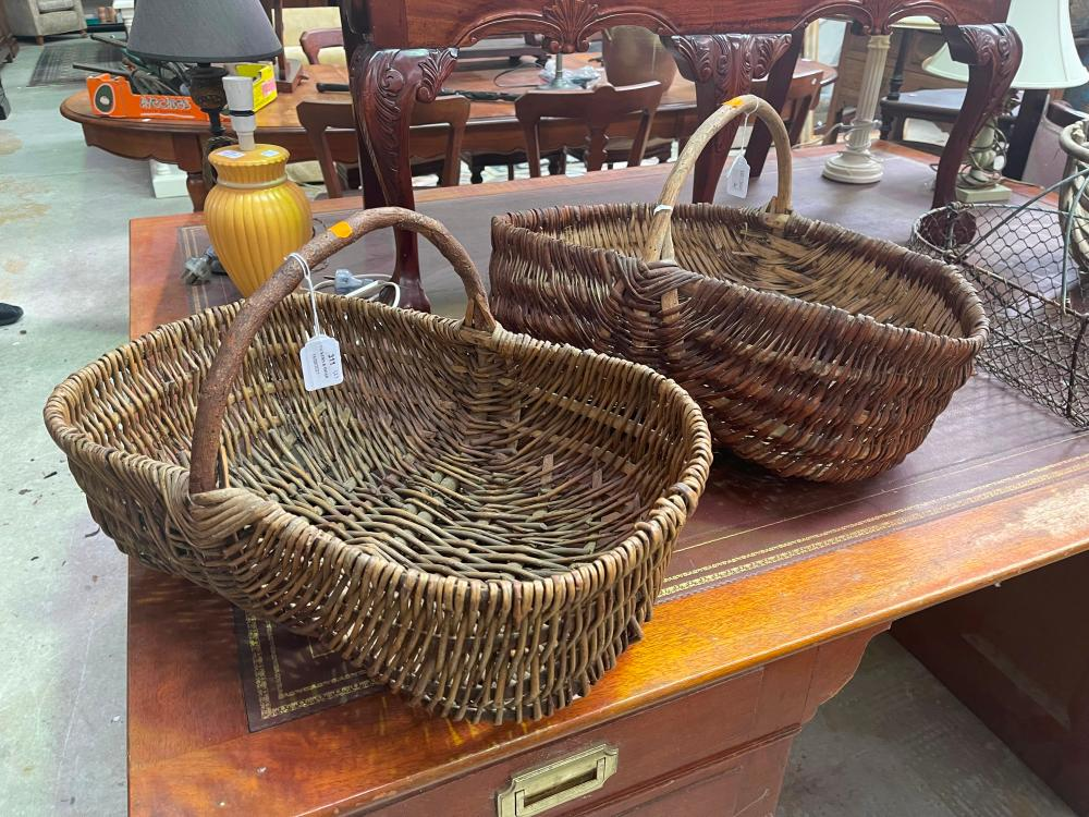 Two antique French cane baskets, approx 54cm W and smaller (2)