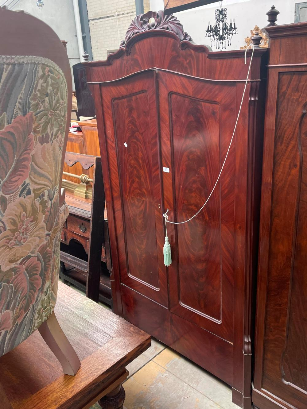 Antique Mahogany two door armoire carved central crest, flambe mahogany panelled doors, approx 195cm h x 103cm W x 48cm D