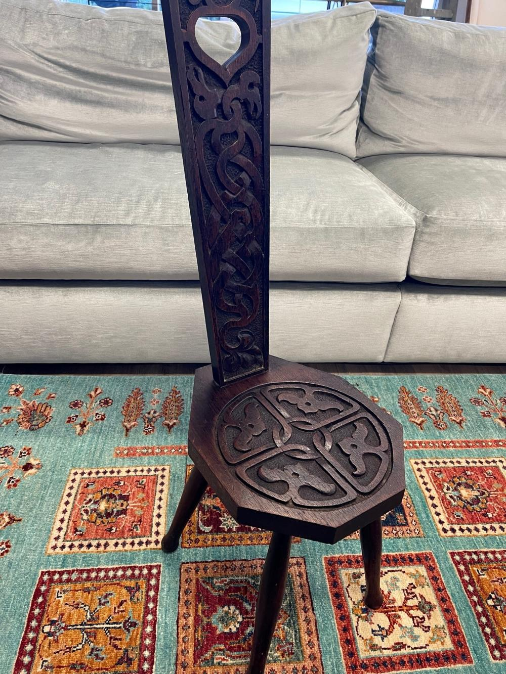 Antique English oak Arts & Crafts spinners chair, carved with Celtic designs