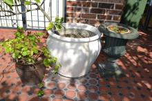 Composite stone garden urn, along with potted citrus tree and salt glazed garden pot (3)