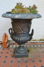 Antique cast iron twin handled garden urn, planted with a succulent, approx 63cm high