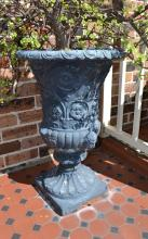Pair of large composite stone painted Renaissance style garden urns, planted with jade trees, each approx 78 cm high (2)