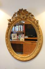 Antique French oval mirror, pierced scrolling floral crest