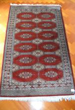 Vintage red ground hand knotted carpet, approx 153 cm x 93 cm