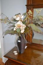 Modern cane work vase with faux flowers and foliage